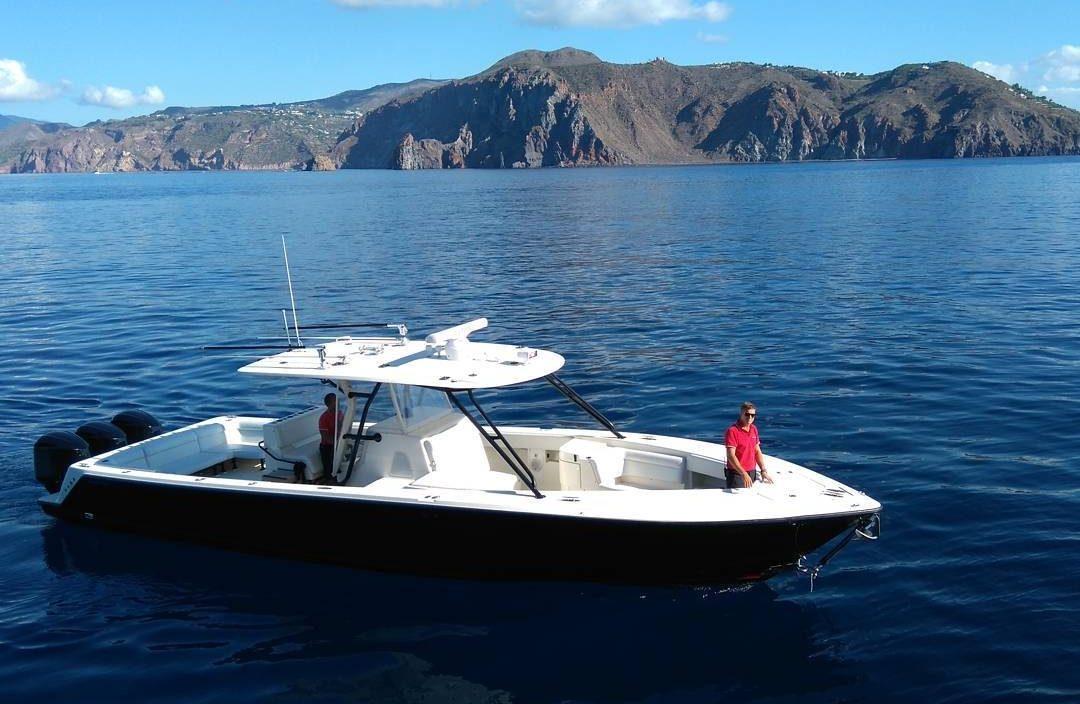2 crew members driving a boat tender