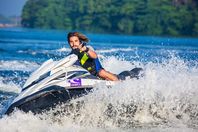 Jet ski instructor riding a personal water craft