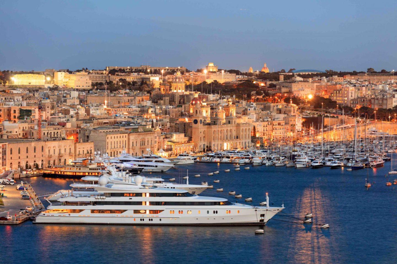 Valletta, Malta. View of Grand harbor from Upper Barrakka Gardens in the evening