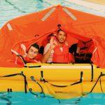 Crew member in a life raft