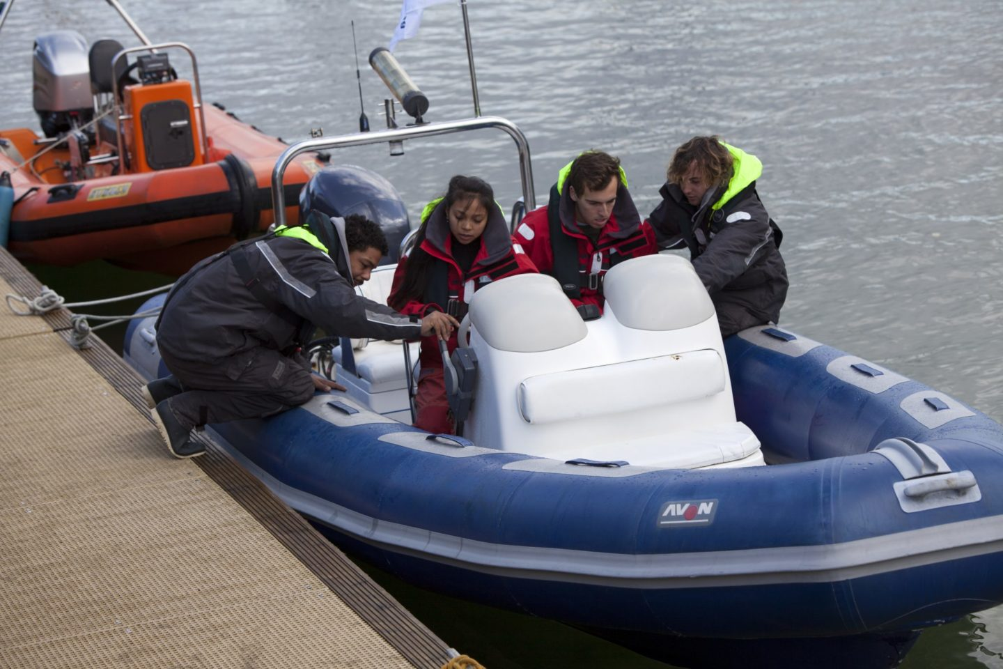 Crew sitting in a small powerboat during their level 2 training to work on yachts